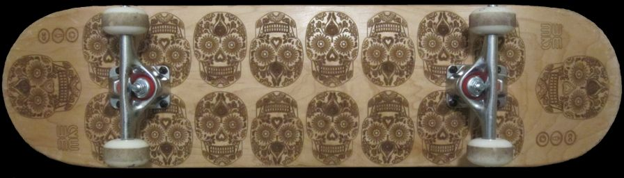 Laser engraved skateboard - sugar skull design